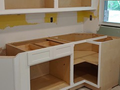 "2"" deep lower buffet cabinets were held off the wall 2"" to give home owner a deeper countertop"